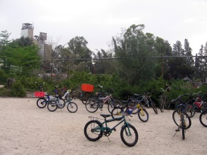 kids' bikes parked by the school bus station