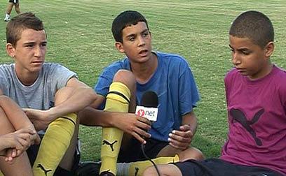 Kids take a break on the field (Photo: Roee Gazit)