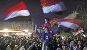 Anti-government protesters gathering in Tahrir Square in downtown Cairo ahead of President Hosni Mubarak's televised speech to the nation late last night.